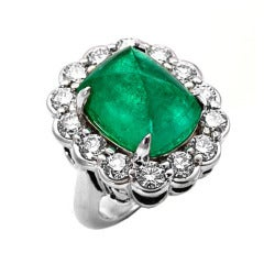 A Colombian Emerald Sugarloaf Cabochon and Diamond Ring