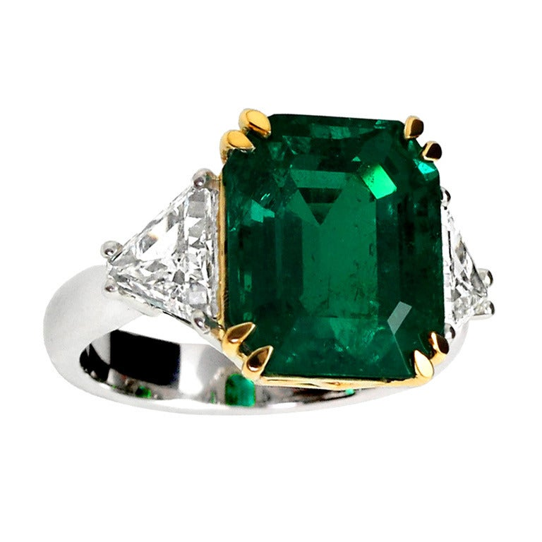 eight carat emerald and three