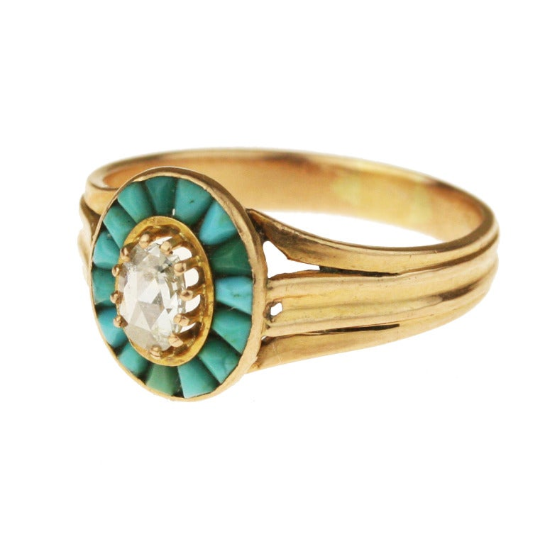 - Victorian Turquoise and Diamond Halo Ring - c. 1885 - 18k yellow gold with a subtle rose cast, 15 tapered sugarloaf cabochon Persian turquoise, one .14 carat rose-cut diamond (faces up as a .40 carat diamond, as rose cut stones are flat