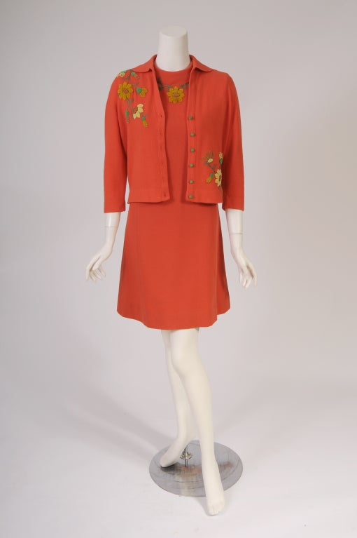 A rare and amazing find, these two pieces have remained together and in excellent condition. This Freida Wolf cashmere dress and cardigan set is a rare example of the hand appliqued custom made clothing produced by women in the 1950's and 1960's.