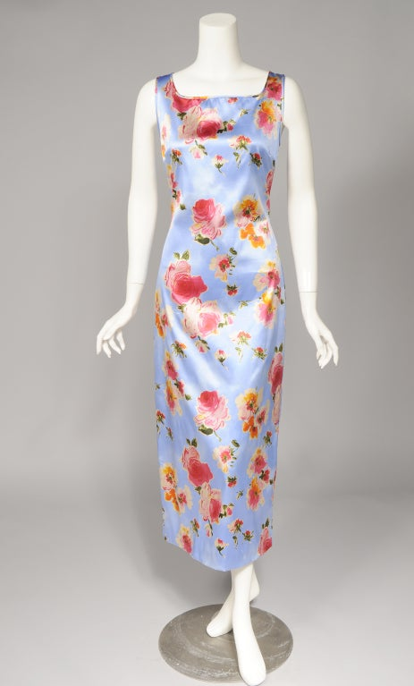Bright pink roses tumble all over a blue sky print background on this silk dress from Dolce & Gabbana. The sleeveless dress has a square neckline and a series of hooks and eyes at the center back for closure. It is in excellent condition and marked