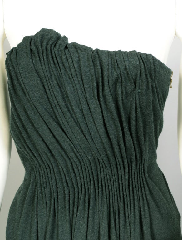 Black/green wool jersey is gathered and draped beautifully by Alber Elbaz working at Lanvin. He was greatly influenced by his years at Geoffrey Beene, which is evident in the beautiful but spare cut and drape of this gown. It is draped over a bottle