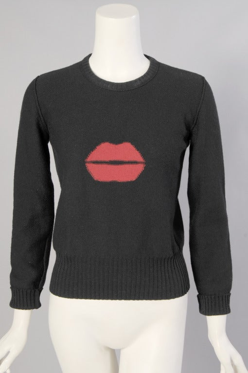 """Sonia Rykiel designed this classic black wool and angora sweater with a fun twist, a great pair of bright  red lips. It is in excellent condition and marked a size 40.  Measurements; Shoulders 15 1/2"""" Bust 36"""" Sleeve 22"""" Length"""
