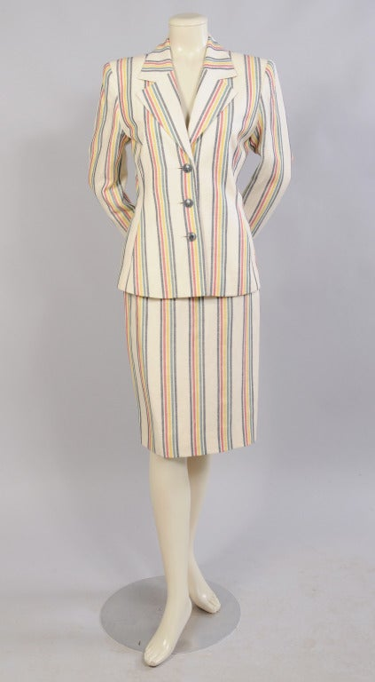 Figure flattering horizontal stripes, in a combination of red, yellow, green and black on cream, create a chic suit from Hermes, Paris. Both the fitted blazer and narrow skirt are fully lined and in excellent condition. The jacket is marked a size