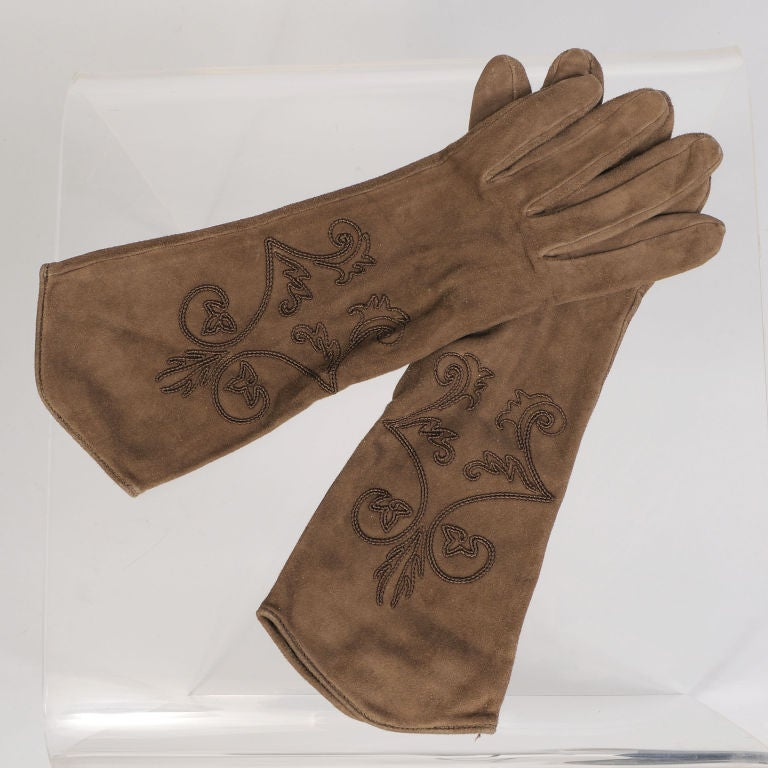 Soutache embroidered gloves in buttery soft suede are lined in black silk for added comfort and wrmth. Designed by Hermes and made in France they are in excellent unworn condition. They are marked a size 7.