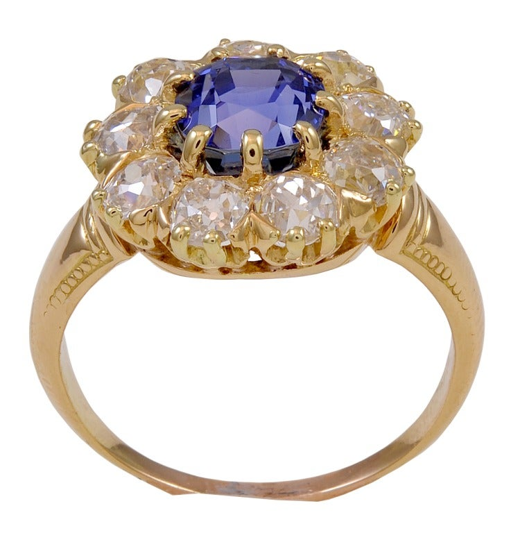 A rare Victorian Tiffany & Co. 2.46ct natural no heat cushion shape sapphire.  Graded by the American Gemological Laboratories as natural, no heat,  origin of Ceylon (Sri Lanka).  The center sapphire is surrounded by nine Old European Cut diamonds