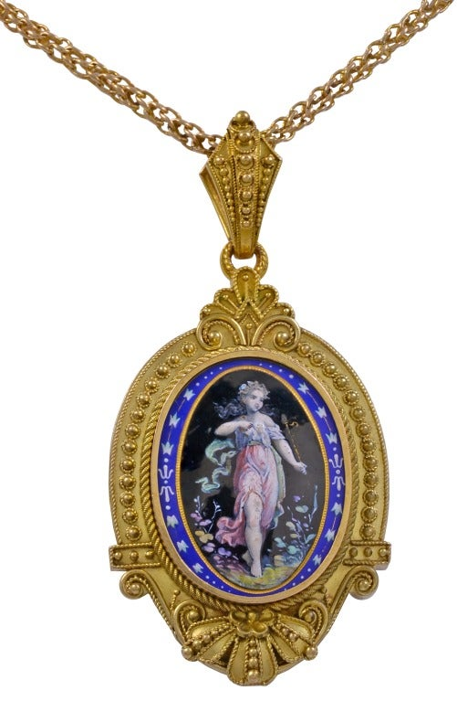 """A very detailed Victorian era enameled locket and earring set, in 14kt yellow gold.  This set has beautiful enamel work.  Pendant/Locket: 2.60"""" x 1.25"""".  Earrings: 1.86"""" x 0.75""""."""