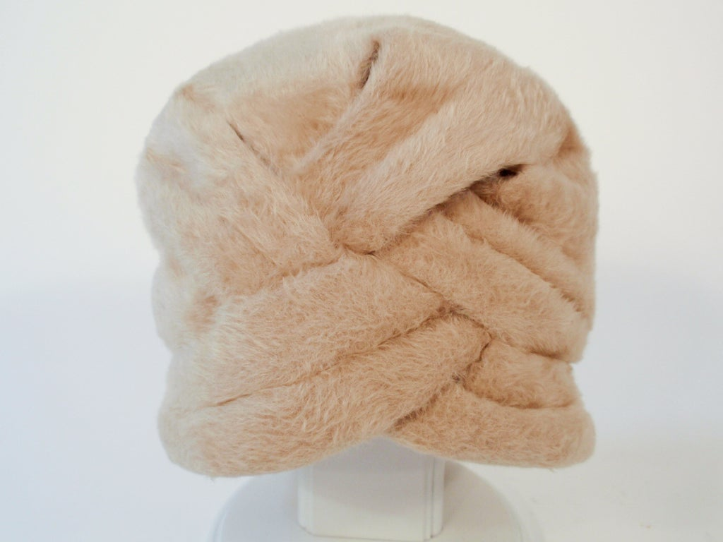 This is a great vintage hat from Jeanne Lanvin. It is a turban style bucket hat that is made of a soft and furry wool felt.