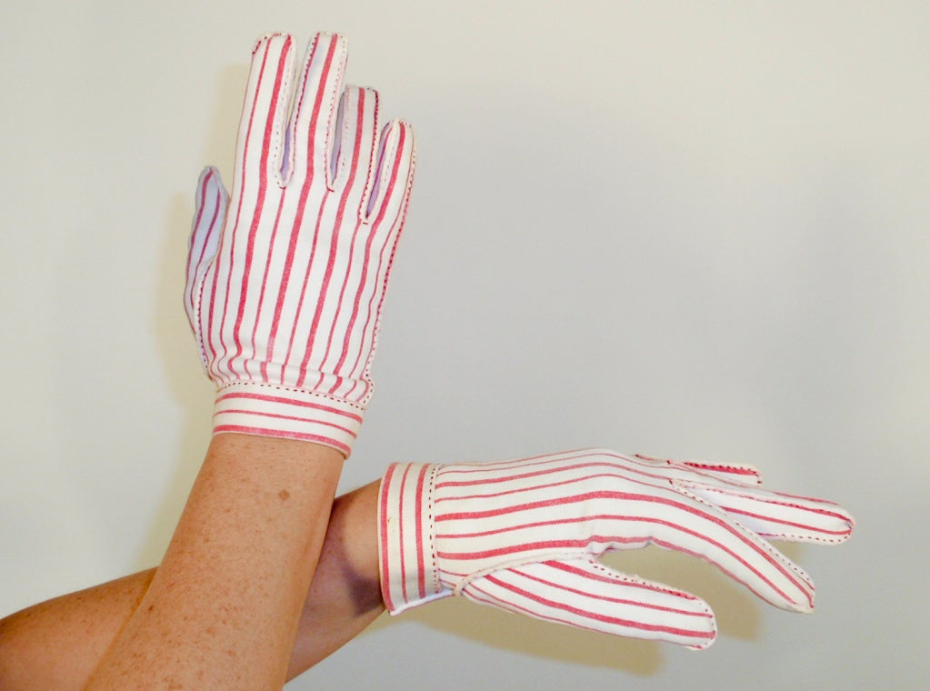 This is a pair of darling little gloves from Hermes. The label reads