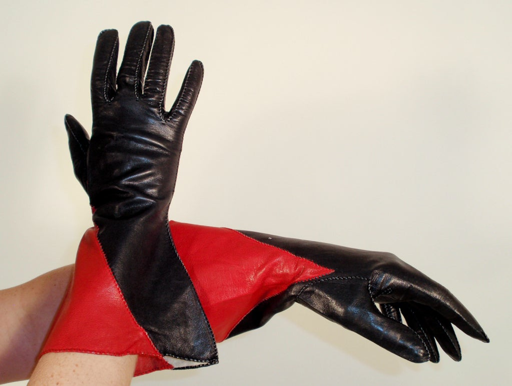 This is a hot pair of fashion gloves, vintage from the 1980's. They are made of a butter soft thin leather, in black and red color block, and are longer with a wide gauntlet. Very cool.