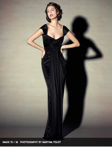 "This is a gorgeous black silk jersey ""Uta"" gown, by Elizabeth Mason Couture. The ""Uta"" gown highlights her signature drape design which contours the curves of the female silhouette to perfection. 