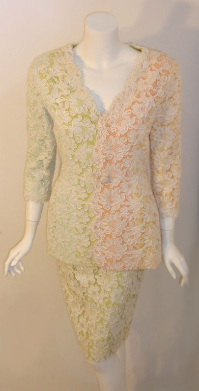This is a white embroidered lace over pastel colors jacket and skirt set by Bob Mackie, from the 1980's. The jacket has a v-neckline, a hidden zipper with button down the front, and a silk lining.  Jacket Measures:  Length: 27 1/2