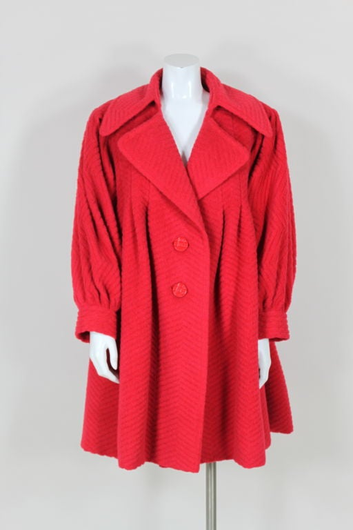 Description s Albert Nipon red wool blend swing coat with very authentic- looking black standing faux fur collar and cuffs. So beautifully constructed and from the the height of the Nipon label's success.