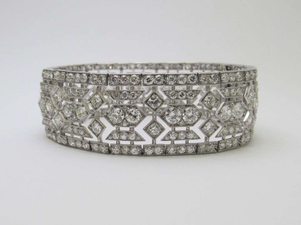 """Magnificent  workmanship. Designed as an open work band of geometric links, millegrain-set with circular diamonds , Estimated weight of the diamonds is 18cts. Signed  """"Tiffany Paris"""" &  Numbered  # 29734"""