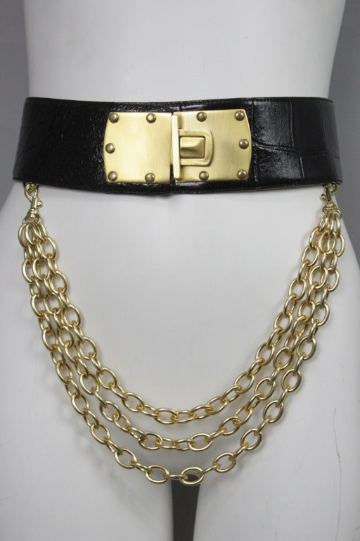 """Luxe alligator skin belt with a wide, matte goldtone clasp and detachable chains that hook onto D-rings on the inside.   Belt length adjustable to about 23"""" minimum and 32"""" maximum when clasped, 34.5"""" total length when laid flat."""