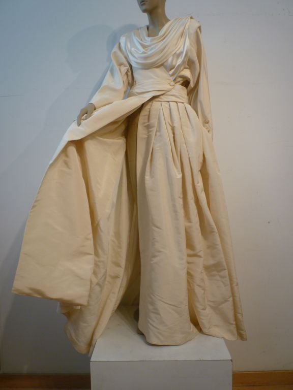 An incredible Haute Couture evening piece from Chanel.  Fashioned entirely from ivory silk satin and taffeta, this beautiful coat dress is in perfect condition and is a size 8-10. Impeccable!