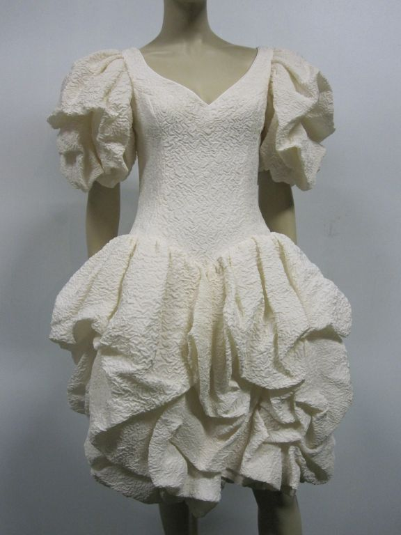 80s Michael Casey pouf cocktail dress of gorgeous ivory crinkled silk.  Lots of ruched fabric in the pouf skirt and cap sleeves!  Size 8