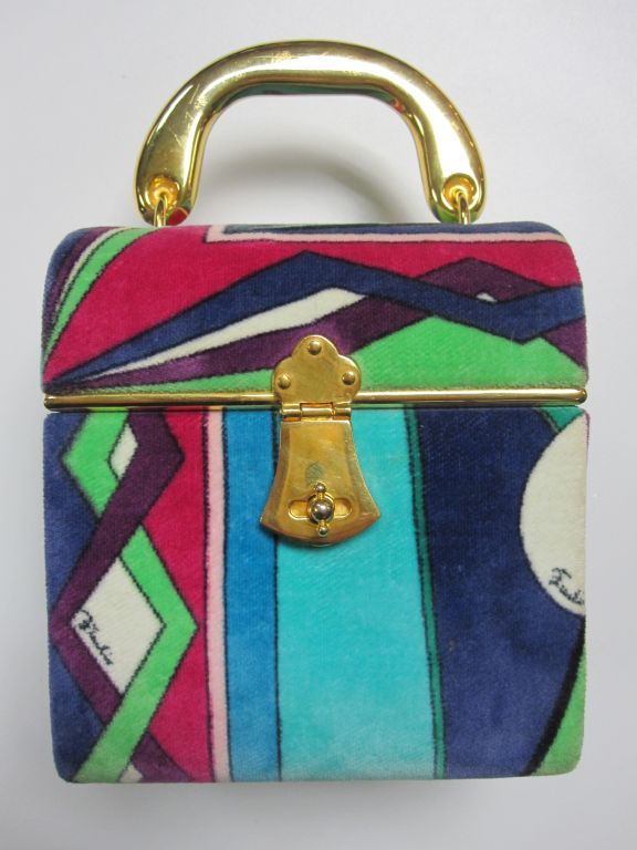 1960s genuine Emilio Pucci colorful velvet print evening bag with gold-tone hardware and fuchsia leather lining.<br />