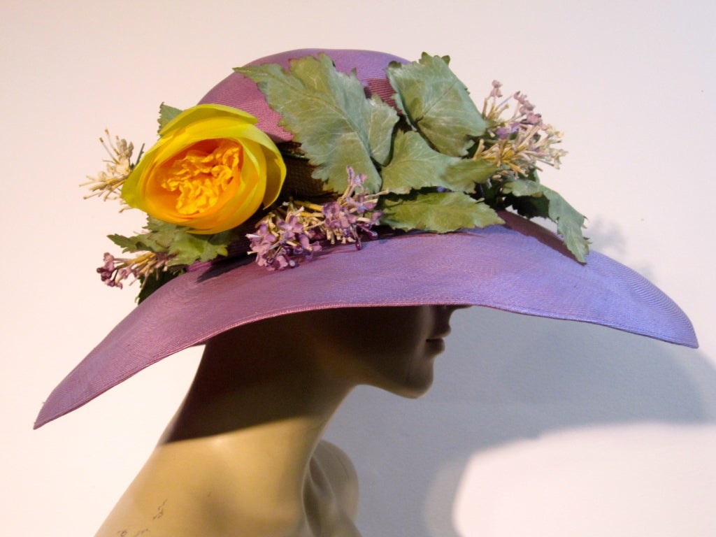 Irene Of New York fine French straw cartwheel hat in lavender with large dramatic brim and open net band under the ivy and yellow rose silk trimmings.  Medium size in very good condition with very slight staining on part of brim.