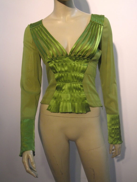 A fabulous sexy Gucci blouse of silk chiffon and satin, in a pleated piped deep V neck and long slim sleeves.  Made with a bit of elastin incorporated in the fabric for shape.  Marked Italian size 40.