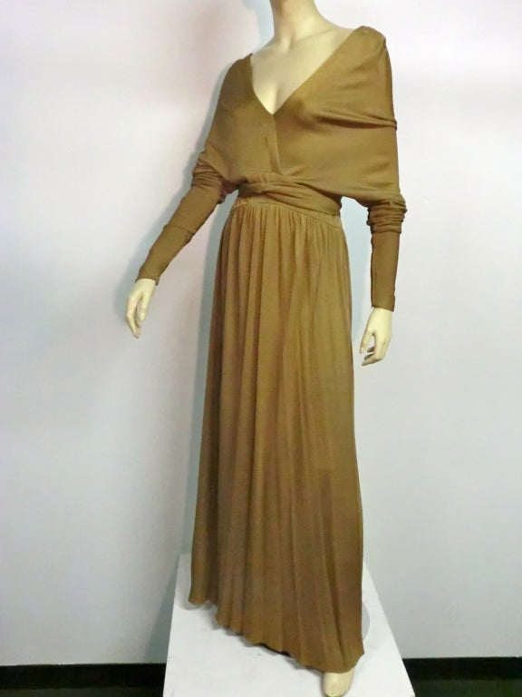 A fantastic tobacco-color silk jersey gown by Elinor Simmons for Malcolm Starr!  Details include a wrap style bodice with dolman sleeves and a waist tie.  Beautiful and sensuous.  Size 6
