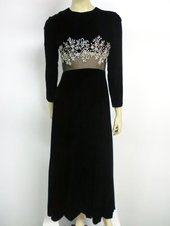A gorgeous 60s Malcolm Starr gown in black silk velvet with sheer illusion midriff and beaded and rhinestone embellishment.  Zips up the back. Size 4-6