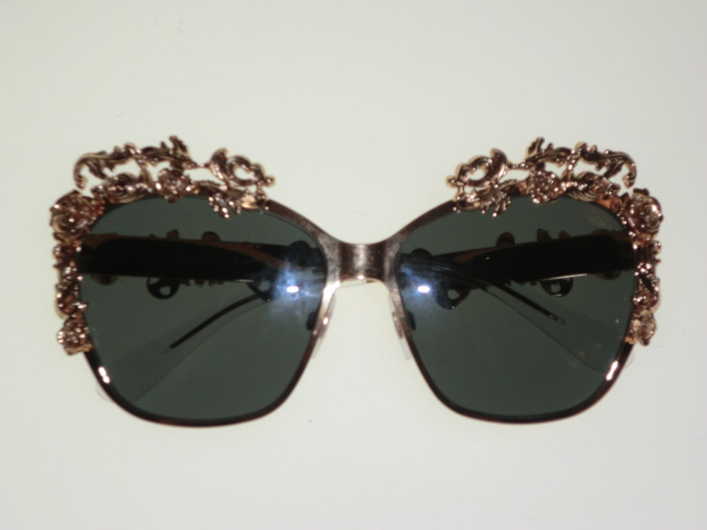 Dolce & Gabbana gold plated 3 dimensional floral embellished aviator style sunglasses.  Mint condition with box and carrying case, never worn.