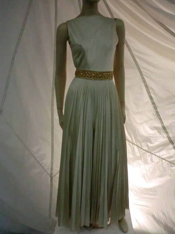 A fantastic and elegant 1960s mint green / gray silk satin evening jumpsuit with very wide knife pleated legs that appear to be a skirt.  Jeweled and embroidered waist band and back zipper. High necked in front and deep V in back.