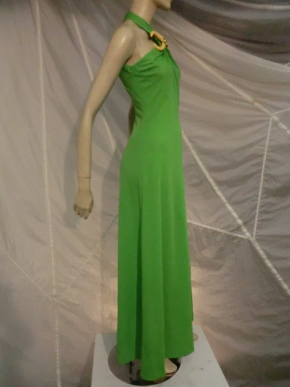 1970s Mignon synthetic jersey gown in lime green:  back zip, halter style sleeveless gown with incredible faux tusk adornment at neckline.