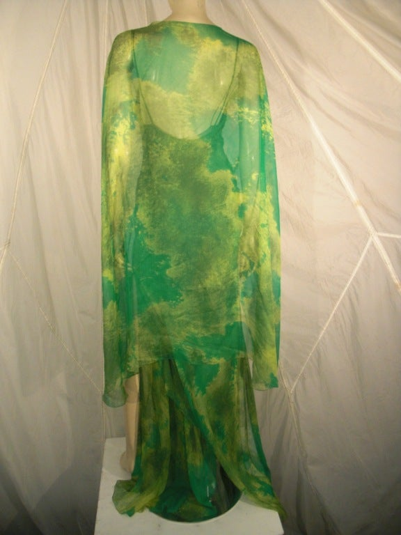 1970s James Galanos silk chiffon print gown with chiffon overlay in abstract organic pattern. Bustline is knotted at center.  Structured underwire bust. Left leg side slit. Overlay is slightly structured at front center hook.