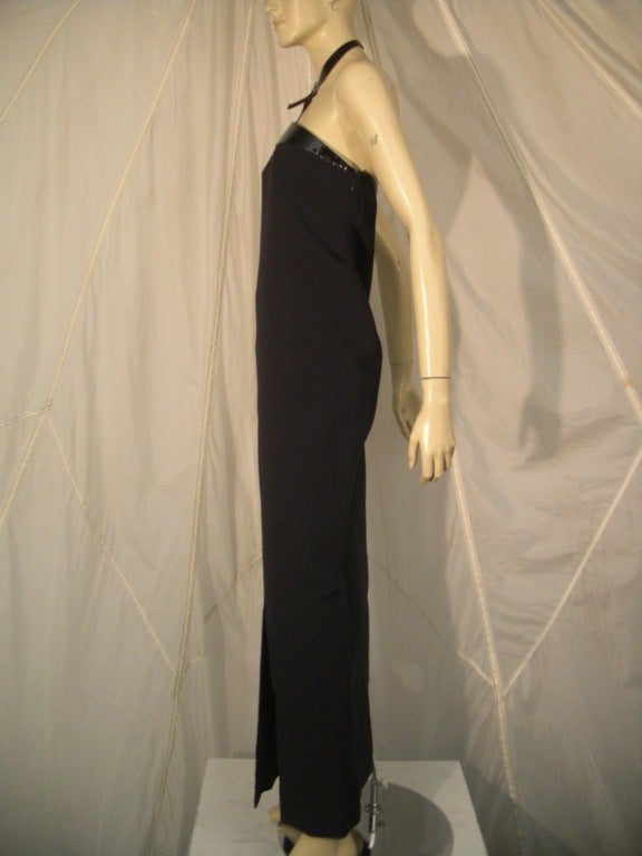 "1990s Tom Ford for Gucci black crepe gown with patent leather harness neckline.  Fully lined.  Neck buckle with ""G."" Side front slit."