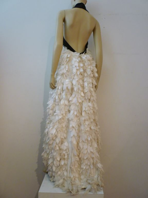 Haute Couture halter gown made for the Lipton Tea heiress.  Black sharkskin halter top with incredibly dense detailed skirt completely covered in white silk satin and chiffon flower petals.  Gorgeous!!