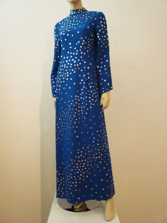 A fantastic Pauline Trigere gown from the late 60s to early 70s in cobalt blue crepe completely covered with scattered sequins and beading. Princess seaming, Nehru neckline and slightly flair sleeves.