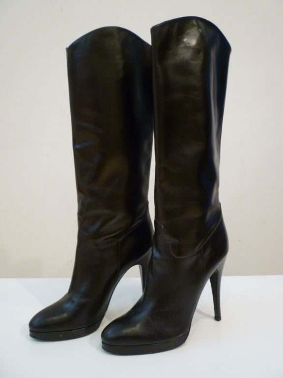Beautiful black stiletto boot from Paris! Platform black leather boot in a size 7.5 US. Subtle western styling, no zipper, slide on.