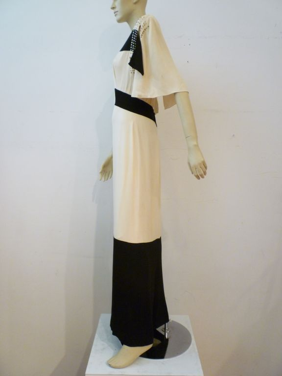 1940s Adrian black and white color-block rayon crepe gown with capelet back, slash detail and geometric sequin blocking.  An incredible piece from the legendary designer of screen and high society!