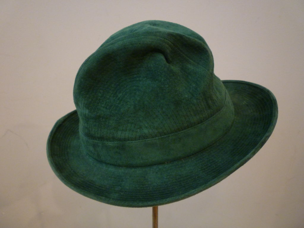 Gucci 70s men's hat made of trapunto stitched green suede with brass toggle hardware at band. Marked a european size 58.
