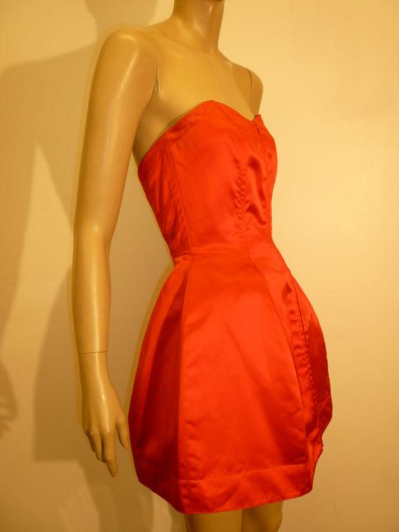 A wonderful Claude Montana 80s silk satin bustier mini dress, boned, zips down front. Marked an Italian 40/American 6.