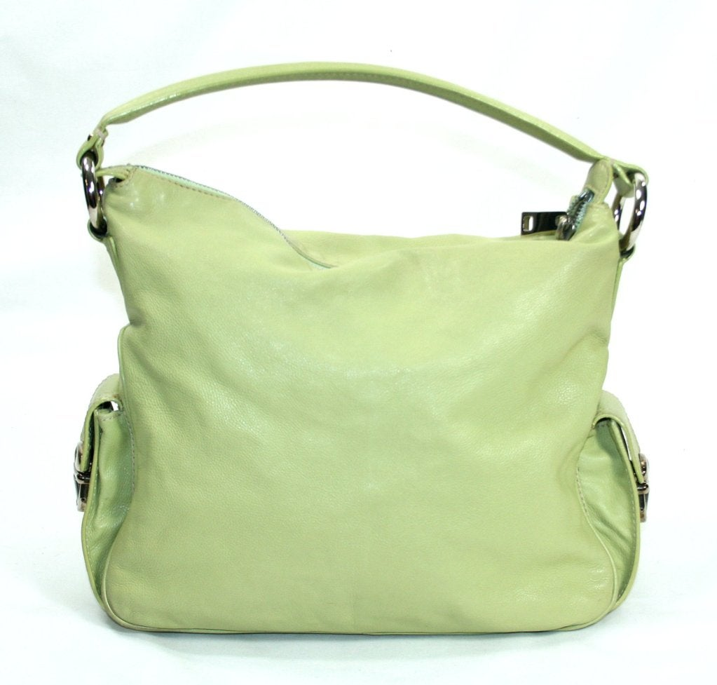 Lime Green Patent Leather Coach tote purse / RARE!. Coach lime green purse Coach lime green small shoulder bag. White leather strap. Tan interior. inches long and inches tall. Coach Bags Shoulder. All data and information provided on this site is for informational purposes only.