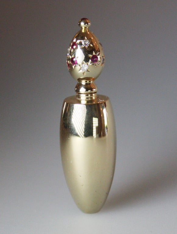 1940's  miniature perfume bottle decorated with rubies and diamonds.