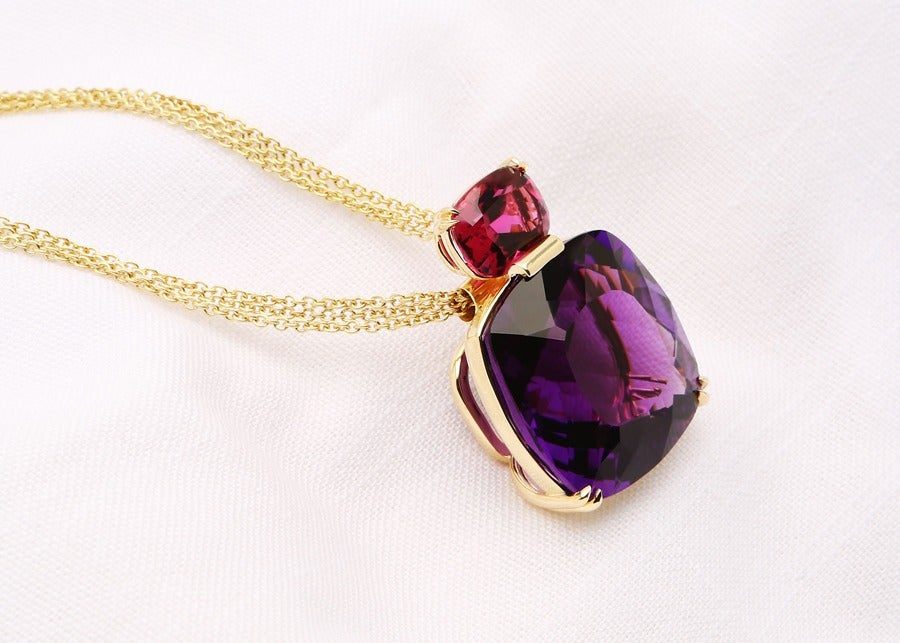 David Precious Gems one of a kind pendant featuring a cushion cut 63 carat amethyst and a vivid rubellite, suspended from a triple strand chain.
