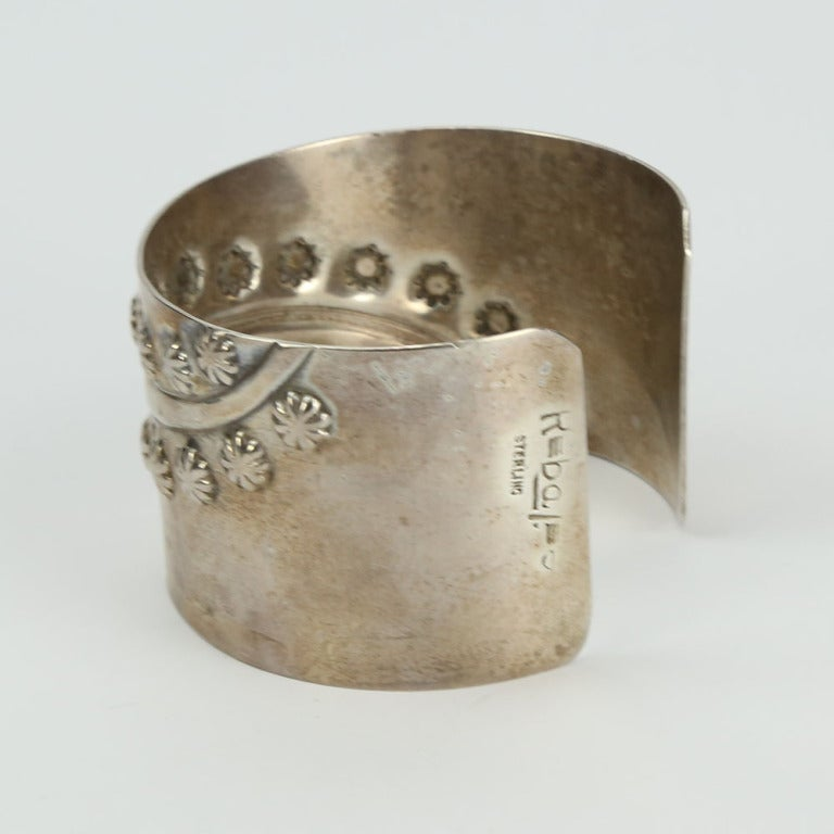 "Modern and Chic Sterling Cuff Bracelet by Francisco Rebajes with streams of flora in relief the cuff measures approx. 1.5"" wide; the opening approx. 1"" and fits an average wrist. Signed: Rebaje with a stylized sideways number 8 STERLING C1950s"