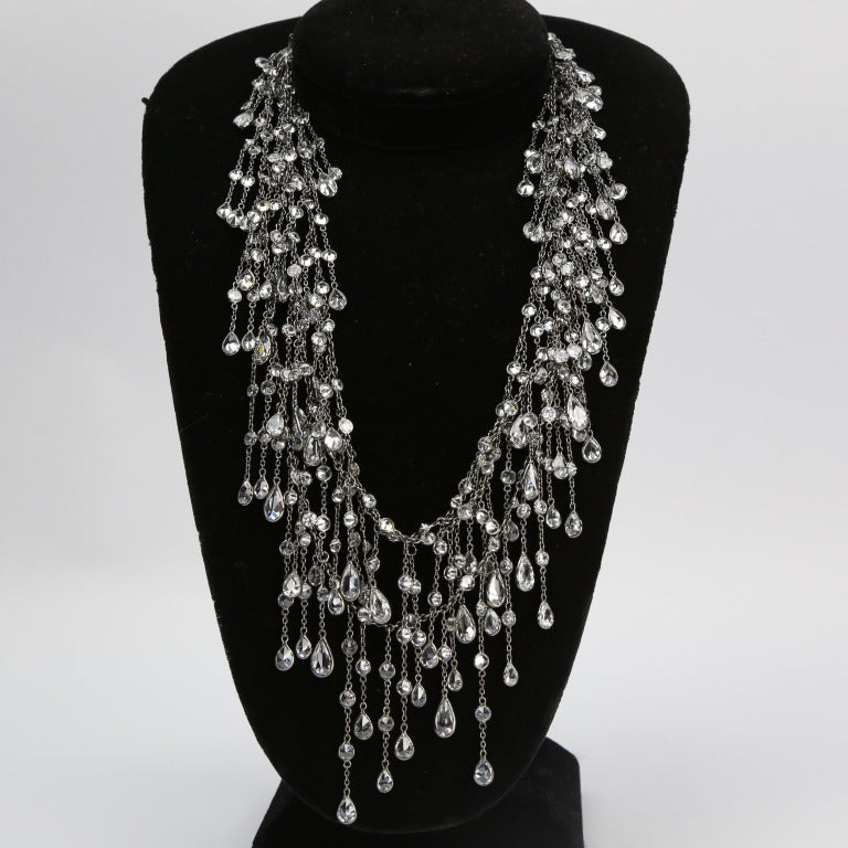 Beautiful and Alluring Swarovski Crystal Cascade Necklace; sterling silver, encased in black rhodium finish; crystal drops, cascading several times around the neck, make this super fun necklace perfect for day or night. Signed, Approx. length: 60