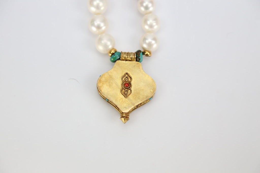 Modernist Pearl Coral and Turquoise Necklace with a Tibetan Gau Gilt Silver Pendant Estate For Sale