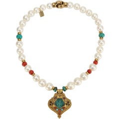 Pearl Coral and Turquoise suspending a Tibetan Gau Gilt Silver Pendant