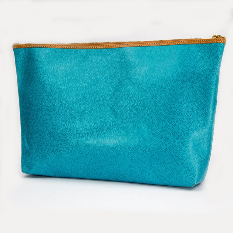 Exquisite in Turquoise Leather Envelope Clutch by Comptoir Sud Pacifique Paris. Tan trim; The exterior has an applied leather logo of Comptoir Sud Pacifique Paris Made in France. A perfect complement to every wardrobe… Illuminating your Look with a