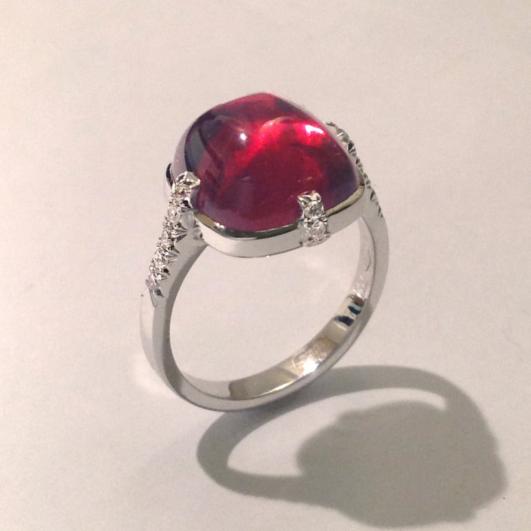 Dalben design 18 kt white gold  ring with a 8,85 carat cabochon red tourmaline and 0,18 carats  round brillant cut Diamonds. The ring is completely hand made in our atelier in Italy Como with a rigorous quality workmanship Ring size 7 - EU 54