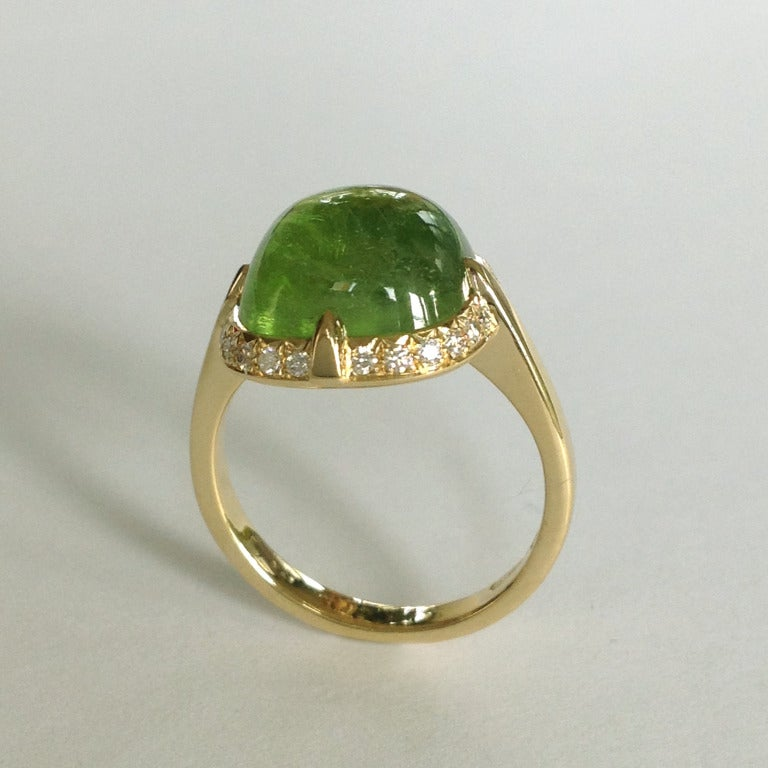 Dalben design 18 kt yellow gold ring with a 9,33 carat cabochon peridot and 0,24 carats round brillant cut Diamonds. The ring is completely hand made in our atelier in Italy Como with a rigorous quality workmanship Ring size 7,5 - EU 55,5 re-sizable