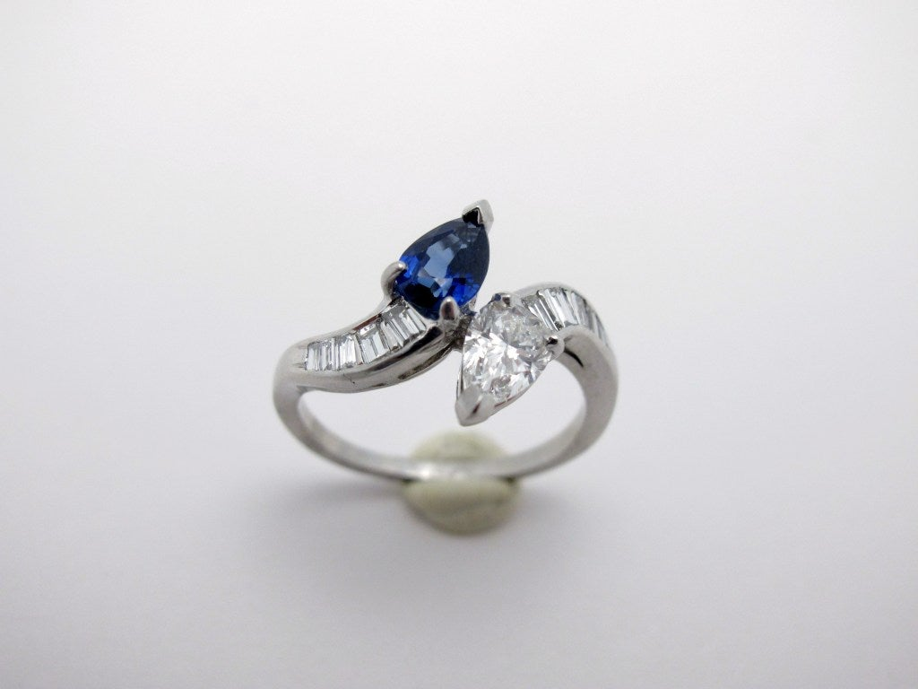 sapphire platinum crossover ring for sale at 1stdibs