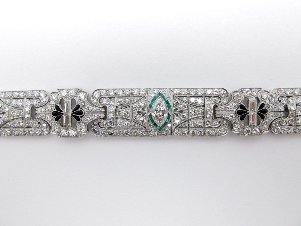 Beautiful Art Deco platinum and diamond bracelet. This stunning piece is set with 240 round brilliant diamonds and 6 baguette diamonds weighing approximately 12.5 carats. The bracelet also contains 3 marquise-cut diamonds average color: G-I and
