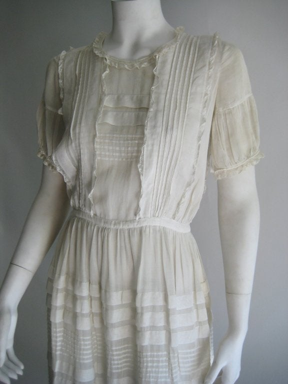 1920s/30s Sweet Dress with lots of detail including pleating and lace. Beautiful Off White Sheer Silk Linen Fabric. Buttons down the back with tight crochet covered buttons. Hook in back at waist. Size approximately US 2-4